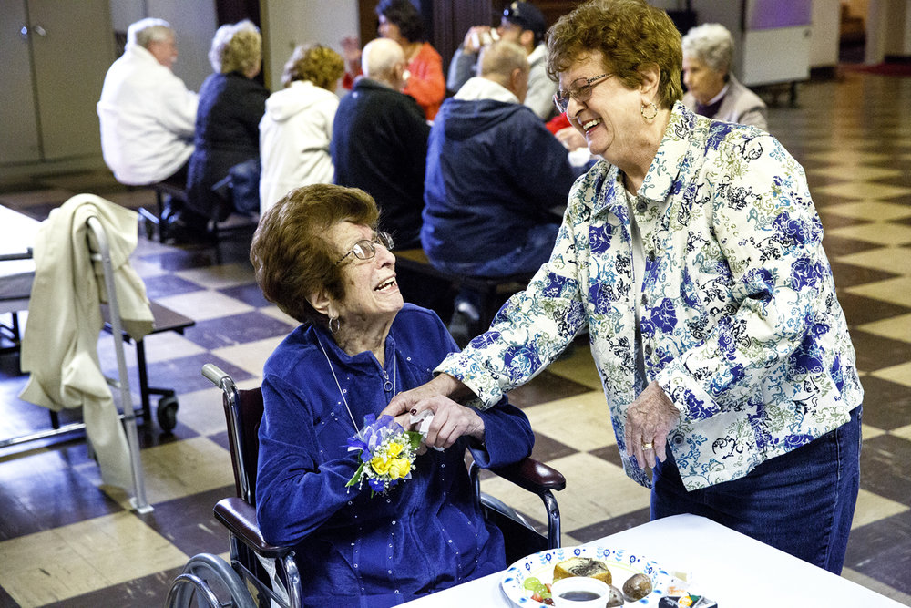 Nancy Bartlett and Della Giacomini Mauer visit during the annual St. Aloysius School alumni brunch Friday, May 5, 2017 in the basement of the church. Mauer will be 99 this month and graduated in 1932, the last class to finish in a temporary Quonset hut that was used before the current school building was completed. Bartlett is Mauer's first cousin and graduated with the class of 1950. Also attending were Mauer's daughters and another cousin, also graduates of the school, and a granddaughter. [Rich Saal/The State Journal-Register]