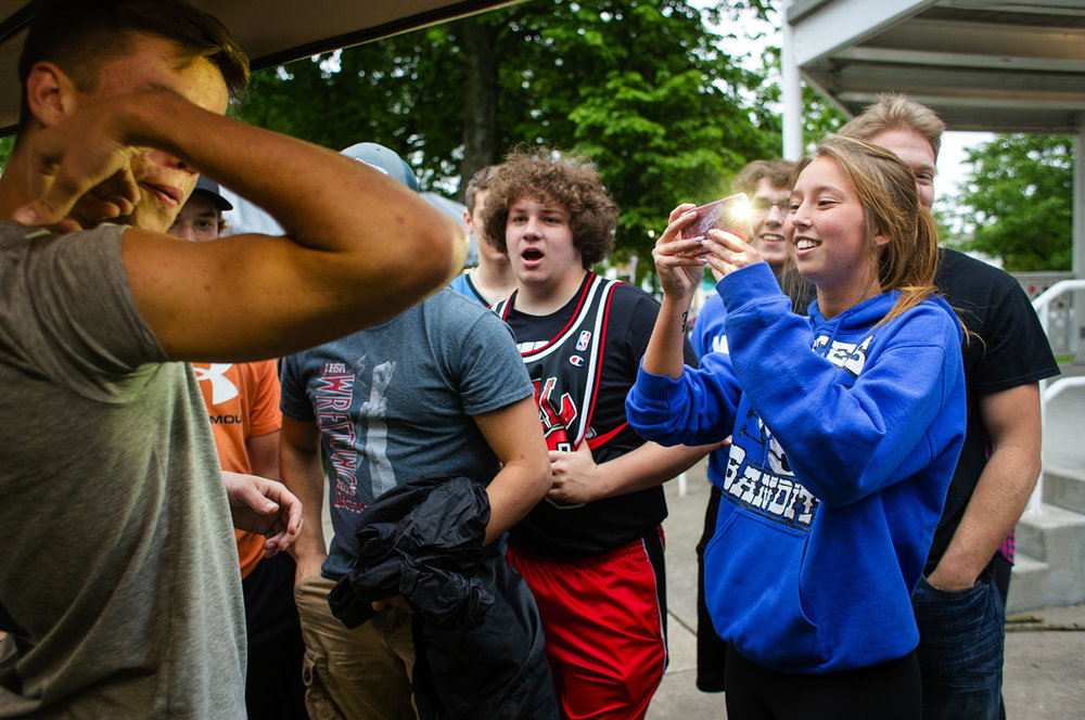 Alyssa McGarvey takes a photo of Colby Bossmann as he shows off a new temporary tattoo that he just had painted on his bicep at Ron's Airbrush during the Auburn Summer Festival in Auburn Thursday, May 11, 2017.  The festival runs through Saturday and features carnival rides and games, carnival food, crafts and live music. [Ted Schurter/The State Journal-Register]