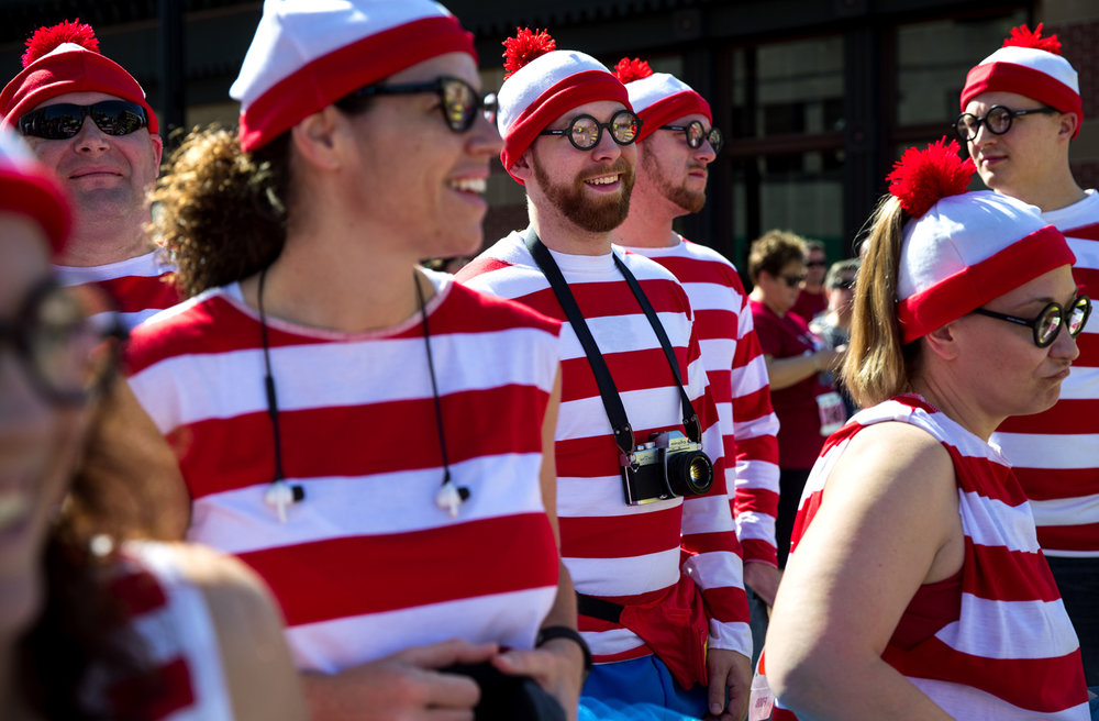 A group of costumed Waldos from Staunton, Ill. waits for the start of the 10th annual Fat Ass 5K & Street Party for Charity Saturday in downtown Springfield. [Ted Schurter/The State Journal-Register]