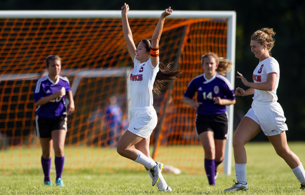 Riverton's Macy Linglio throws her arms in the air as she celebrates the Hawks victory against Williamsville during the Class 1A Riverton Regional girls soccer match Friday, May 12, 2017. [Ted Schurter/The State Journal-Register]
