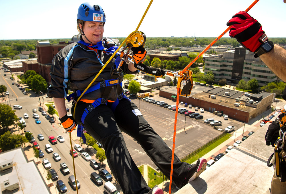 Kristin Shaughnessy of Springfield takes a breath as she prepares to step over the edge and rappel 130 feet down the east face of the President Abraham Lincoln DoubleTree hotel in downtown Springfield Saturday, May 13, 2017. The event was a fundraiser for Sparc, a nonprofit dedicated to enriching the lives of people with intellectual and developmental disabilities, [Ted Schurter/The State Journal-Register]