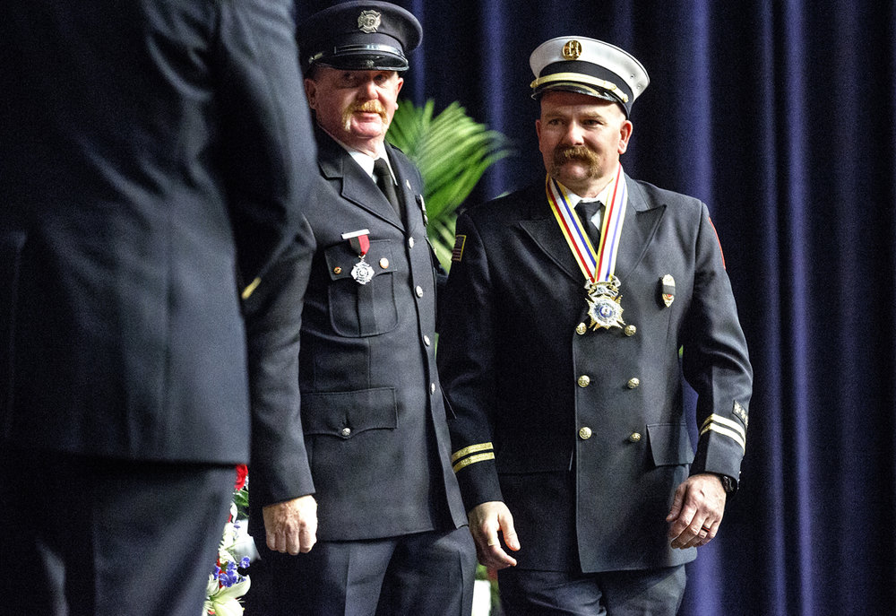 Capt. Michael Smalley of the Nokomis fire department received a Medal of Honor during the 24th Illinois Fallen Firefighter Memorial and honor awards ceremony Tuesday, May 9, 2017 at the Prairie Capital Convention Center. At the scene of a house fire Jan. 5, 2016 in Nokomis, Smalley rushed into a burning house and rescued an 18 month-old girl. The award is the highest award given by the organization. [Rich Saal/The State Journal-Register]