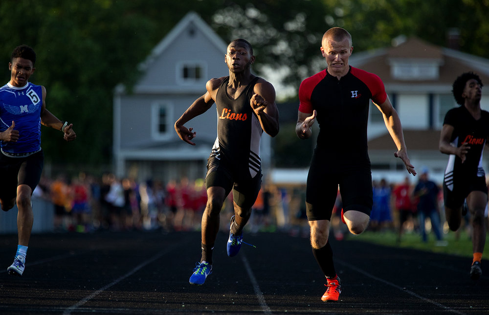 Highland's Tyler Higgins beats Lanphier's Jairus Jackson by one hundreth of a second in the 200 meter dash during the 2017 2A Springfield Sectional at Memorial Stadium Thursday, May 18, 2017.  [Ted Schurter/The State Journal-Register]