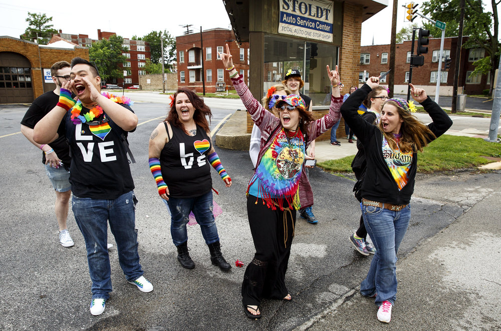 A group of friends from Mount Sterling watched the first Pride Parade from the corner of Fifth and Cook streets before jumping in and joining the procession during Springfield PrideFest Saturday, May 20, 2017.  [Rich Saal/The State Journal-Register]