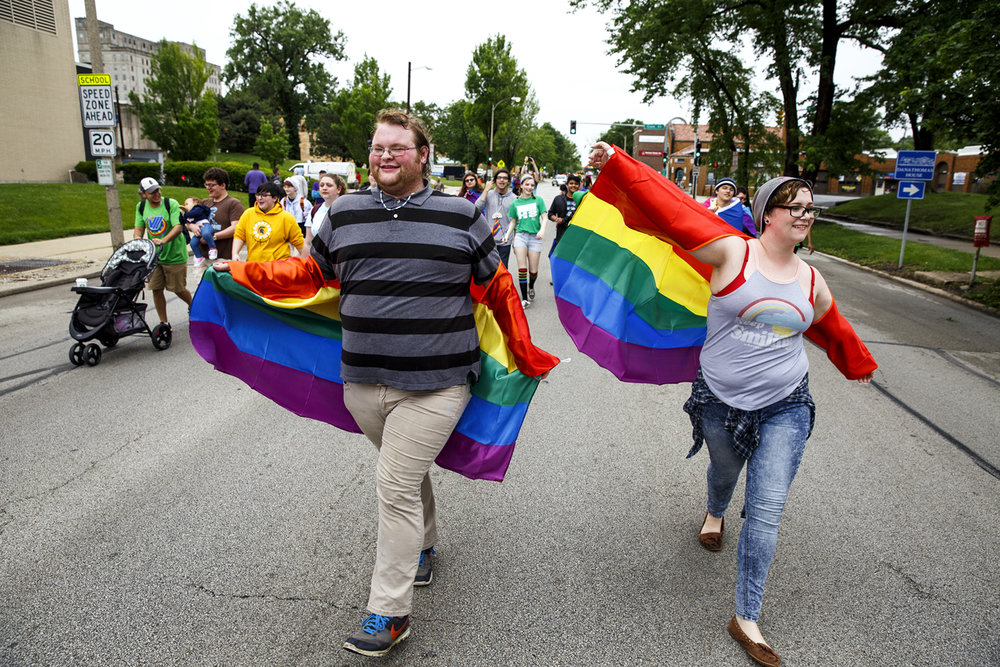 Donnie Sykes and Zoe Blevins march in the first Pride Parade at Springfield PrideFest Saturday, May 20, 2017.  [Rich Saal/The State Journal-Register]