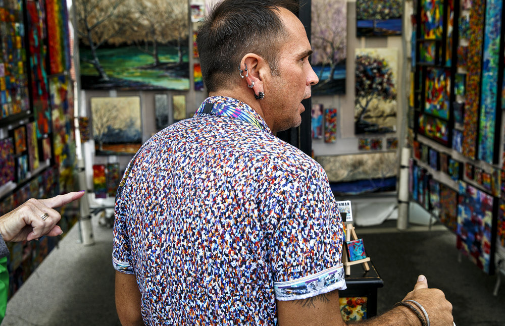 Robert Cornman, an acrylic painting artist from Lakeland, Fla., visits with customers in his booth at the Old Capitol Art Fair Saturday, May 20, 2017. [Rich Saal/The State Journal-Register]