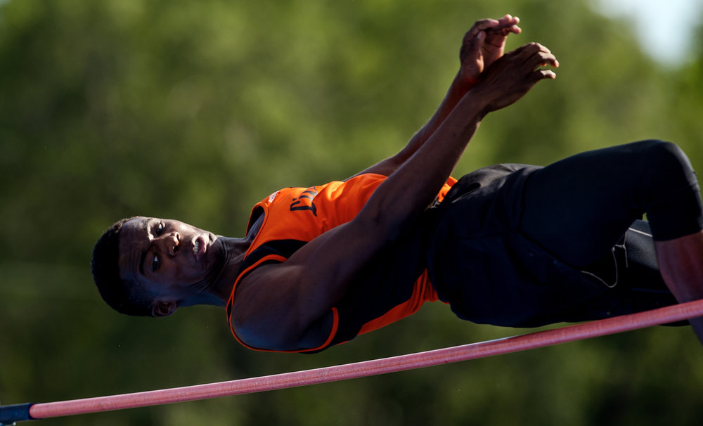 Lanphier's A'Jonte Lee peers down as he elevates above the high jump bar during the 2017 2A Springfield Sectional at Memorial Stadium Thursday, May 18, 2017.  Lee and teammate Karl Wright both cleared 6-07 feet to advance to the state meet. [Ted Schurter/The State Journal-Register]
