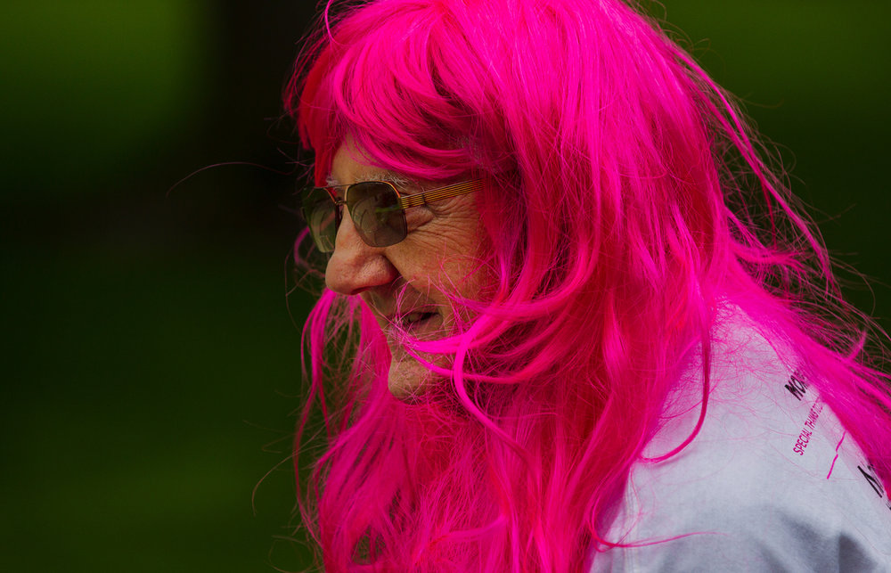 Ed McDougall of Petersburg donned a long pink wig for the 2017 Komen Springfield Race for the Cure Friday, May 19, 2017. [Ted Schurter/The State Journal-Register]
