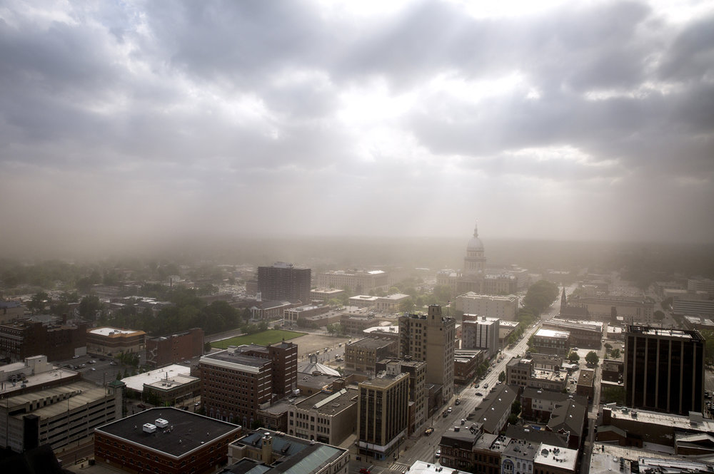 A dust storm driven by wind gusts in excess of 40 mph swept across central Illinois and into the city of Springfield Wednesday, May 16, 2017, creating a hazy view of the downtown skyline in a view from the Wyndham City Centre. The storm created blackout conditions on roads in the area that lead to several accidents. [Rich Saal/The State Journal-Register]