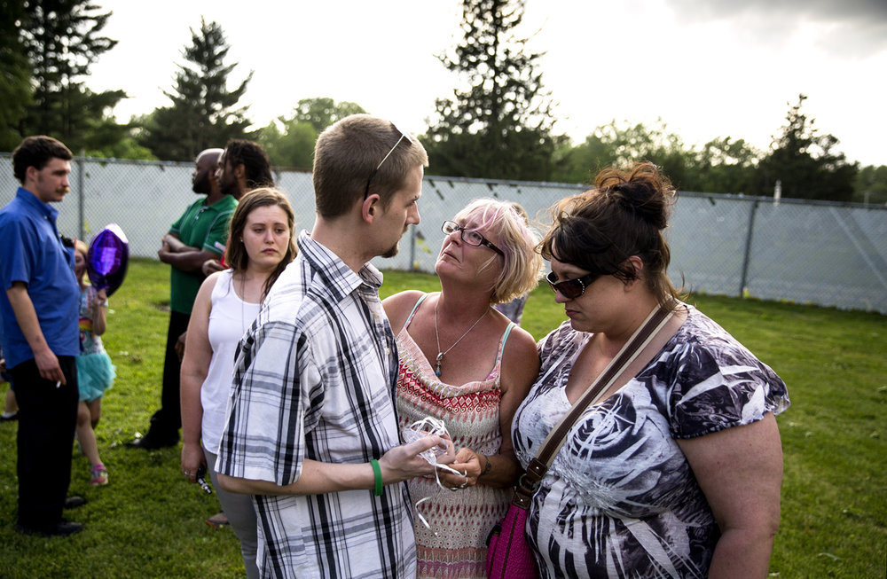 Diane Folder, center, is comforted by Issac Brello and Tiffany Ridge during the celebration of the life of Folder's daughter, Sammi Cody-Neuhoff, at the Chatham VFW Wednesday, May 16, 2017. Cody-Neuhoff died Friday as a result of her heroin addiction. [Rich Saal/The State Journal-Register]