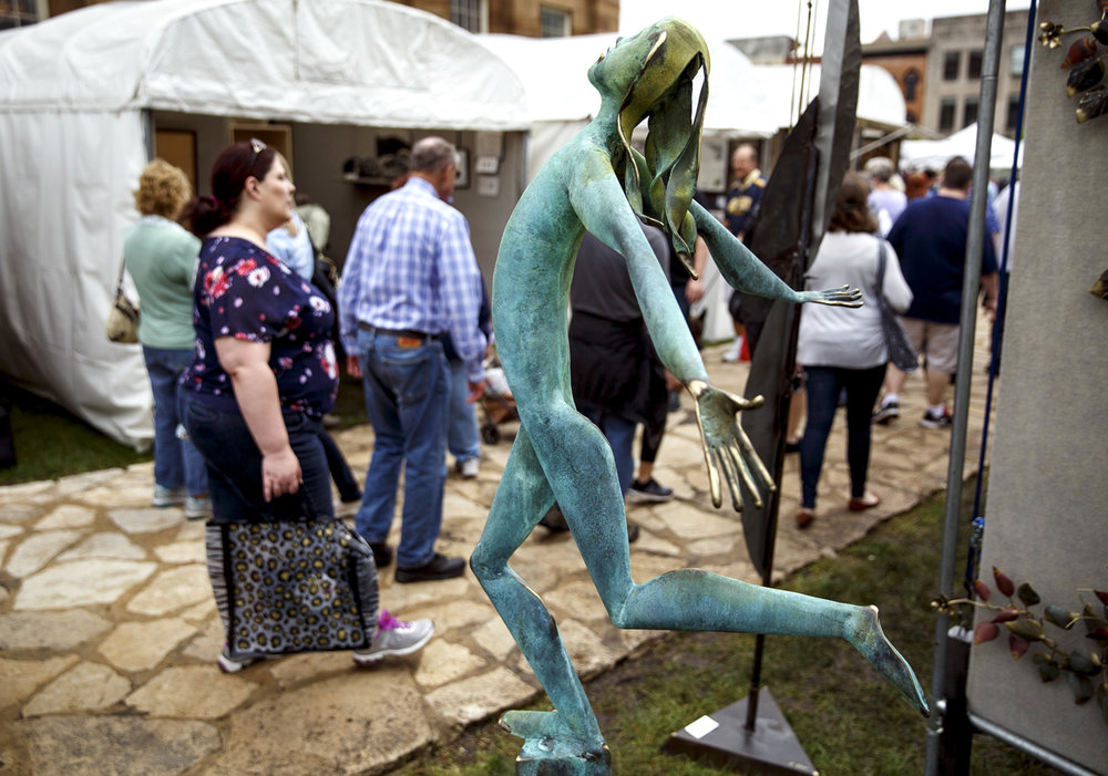 A sculpture by Vermillion, Ohio artist Thomas Yano does some people watching at the Old Capitol Art Fair Saturday, May 20, 2017. [Rich Saal/The State Journal-Register]