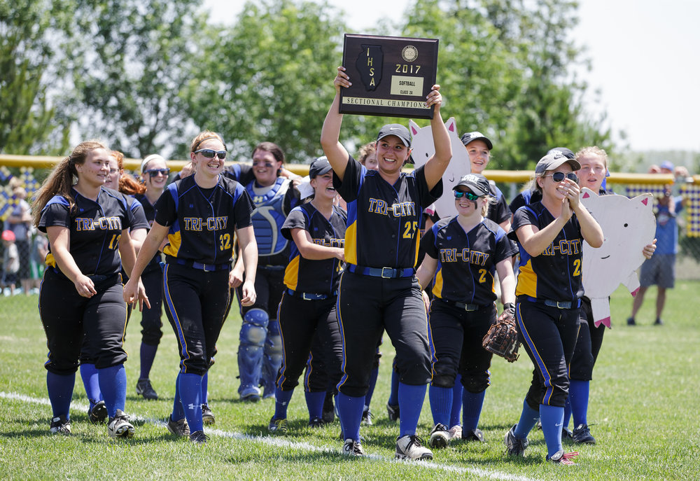 Tri-City's Georgia Miller (25) hoists up the championship plaque as the Tornadoes thank their fans after defeating Williamsville 4-3 in the Class 2A Williamsville Sectional Championship game at Jane Grebner Field, Saturday, May 27, 2017, in Williamsville, Ill. [Justin L. Fowler/The State Journal-Register]