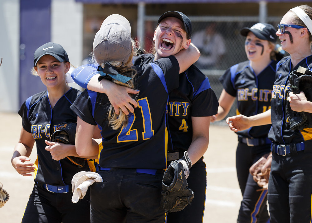 Tri-City's Aubrey Hunt (4) celebrates with Tri-City's Payton Sturdy (21) after the Tornadoes defeated Williamsville 4-3 during the Class 2A Williamsville Sectional Championship game at Jane Grebner Field, Saturday, May 27, 2017, in Williamsville, Ill. [Justin L. Fowler/The State Journal-Register]