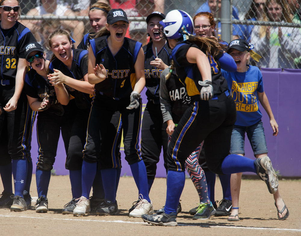 Tri-City's Aubrey Hunt (4) is welcomed to home plate by her teammates after a two-run home run against Williamsville in the third inning during the Class 2A Williamsville Sectional Championship game at Jane Grebner Field, Saturday, May 27, 2017, in Williamsville, Ill. [Justin L. Fowler/The State Journal-Register]