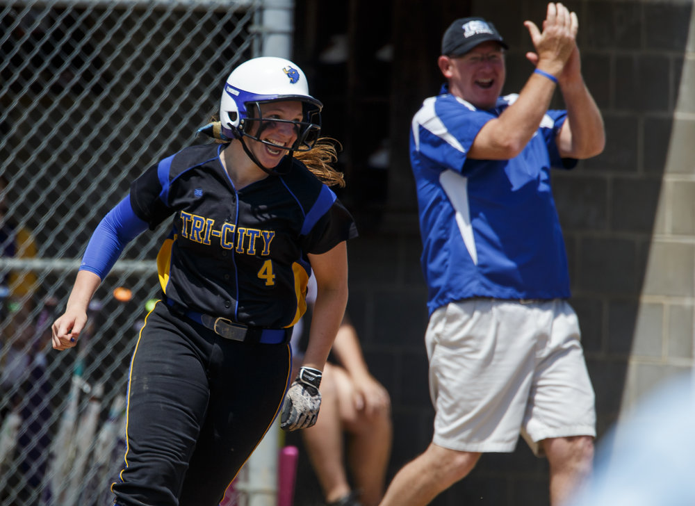 Tri-City's Aubrey Hunt (4) reacts after two-run home run against Williamsville in the third inning during the Class 2A Williamsville Sectional Championship game at Jane Grebner Field, Saturday, May 27, 2017, in Williamsville, Ill. [Justin L. Fowler/The State Journal-Register]