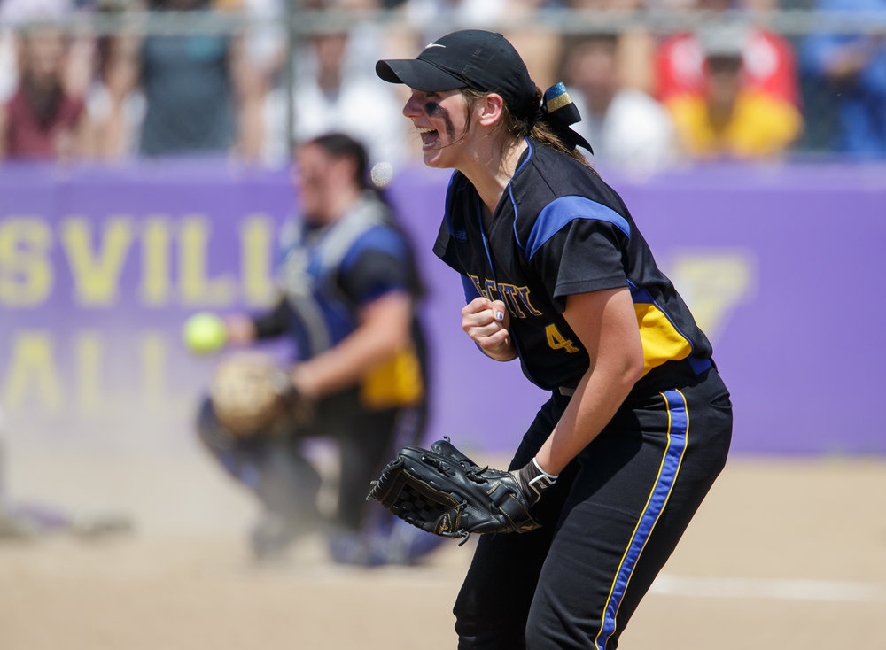Tri-City's Aubrey Hunt (4) screams out after the throw-in from the outfield gets the out at home to end the third inning during the Class 2A Williamsville Sectional Championship game at Jane Grebner Field, Saturday, May 27, 2017, in Williamsville, Ill. [Justin L. Fowler/The State Journal-Register]