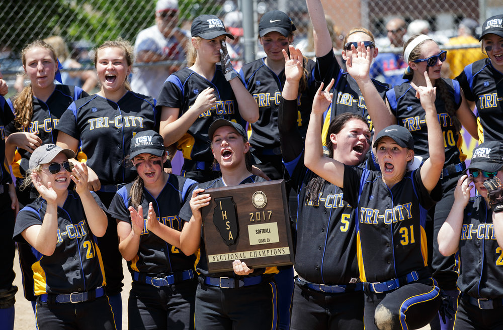 Tri-City celebrates with their championship plaque after defeating Williamsville 4-3 in the Class 2A Williamsville Sectional Championship game at Jane Grebner Field, Saturday, May 27, 2017, in Williamsville, Ill. [Justin L. Fowler/The State Journal-Register]
