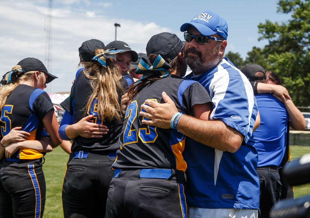 Tri-City softball head coach Brad Sturdy hugs Tri-City's Hailey Patrick (23) after the Tornadoes were defeated 9-5 by St. Joseph Ogden during the Class 2A Athens Supersectional at Athens High School, Monday, May 29, 2017, in Athens, Ill. [Justin L. Fowler/The State Journal-Register]