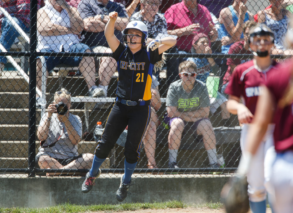 Tri-City's Payton Sturdy (21) leaps up celebrating a two-run single from Tri-City's Katie Jarrett (5) against St. Joseph Ogden in the third inning during the Class 2A Athens Supersectional at Athens High School, Monday, May 29, 2017, in Athens, Ill. [Justin L. Fowler/The State Journal-Register]