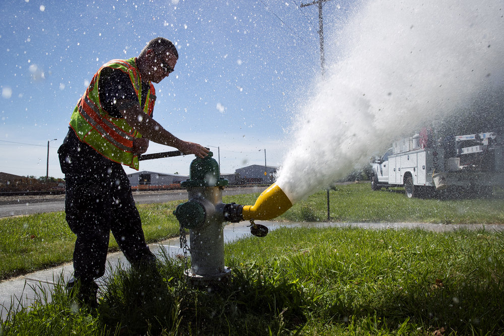 Springfield Firefighter Mark Ballinger tests the water pressure of a fire hydrant on 19th Street Monday, May 22, 2017. The testing will continue daily Monday through Friday from 8:30 a.m. to 4 p.m. until August to ensure the  hydrants are operating efficiently for fire protection purposes. Water can become discolored in service areas located in the vicinity of the hydrant tests and clothes washing should be delayed until the tap water runs clear to avoid discoloration. [Ted Schurter/The State Journal-Register]
