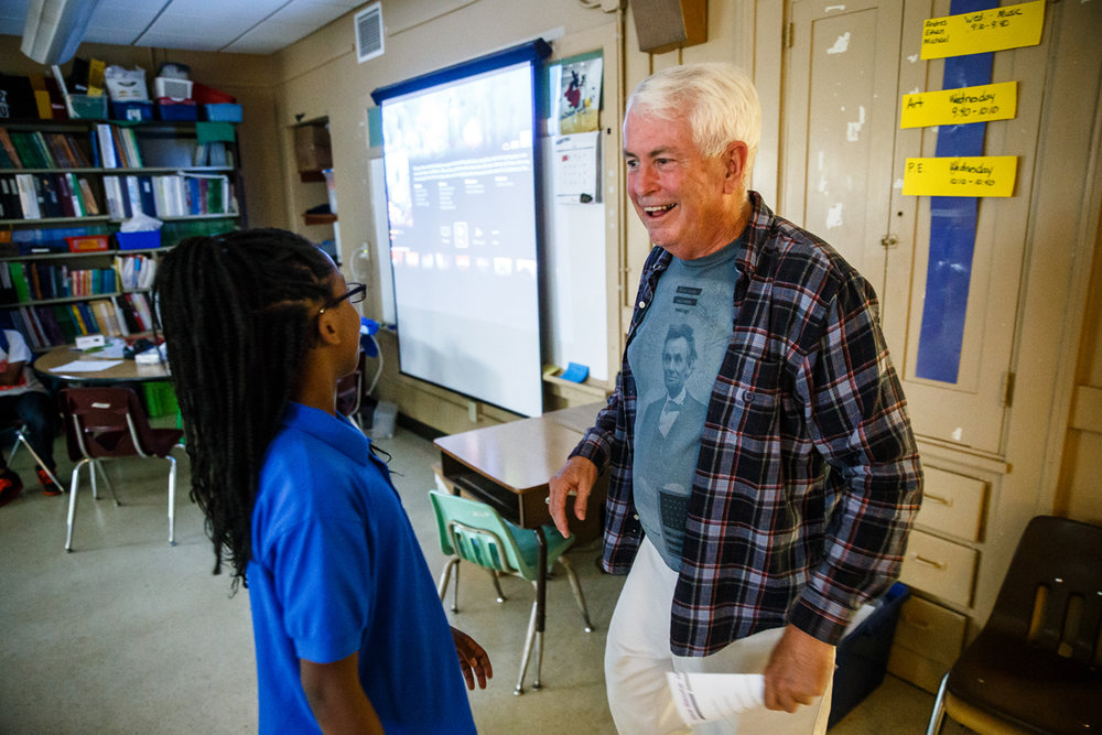 Bill Armitage, right, checks in on his old classroom when he attended Dubois Elementary School 65 years ago while on a tour by Dubois Student Ambassador, Amania Donelson, 10, left, after a ceremony for the school celebrating its 150th anniversary, Tuesday, May 23, 2017, in Springfield, Ill. [Justin L. Fowler/The State Journal-Register]