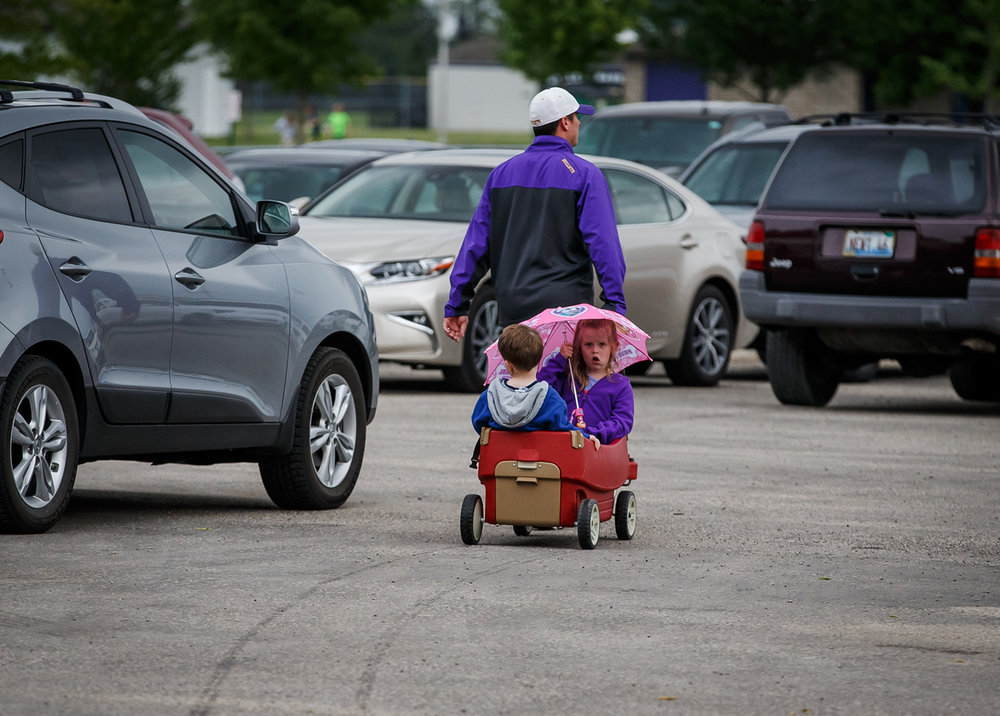 Ellie Halford, 5, and her brother Brennan, 2, hitch a ride via their father, B.J. Halford, to the Williamsville vs. Dupo softball game in the Class 2A Williamsville Sectional at Jane Grebner Field, Wednesday, May 24, 2017, in Williamsville, Ill. [Justin L. Fowler/The State Journal-Register]