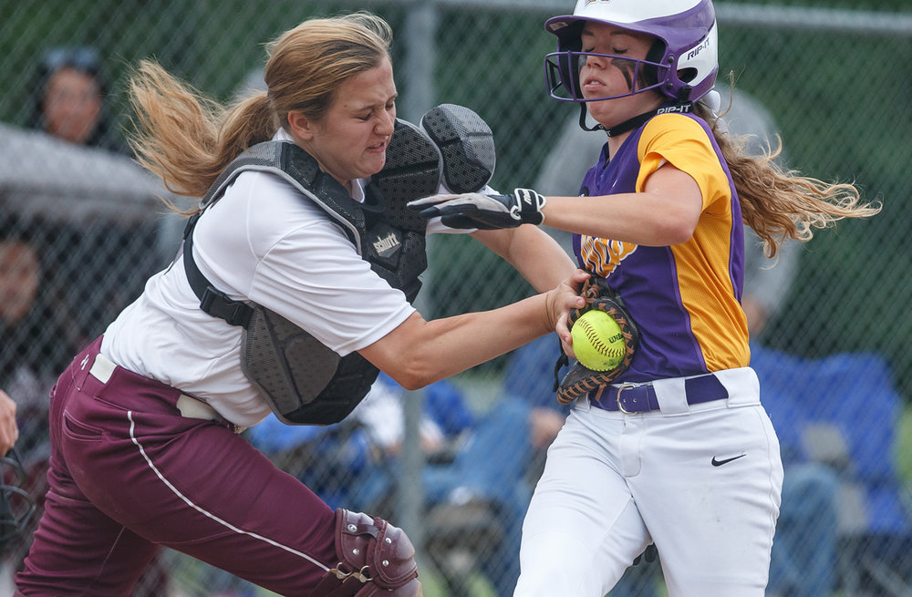 Williamsville's Emma Walbert (7) is tagged out by Dupo's Stormy Sellers (5) at home plate in the second inning during the Class 2A Williamsville Sectional at Jane Grebner Field, Wednesday, May 24, 2017, in Williamsville, Ill. [Justin L. Fowler/The State Journal-Register]