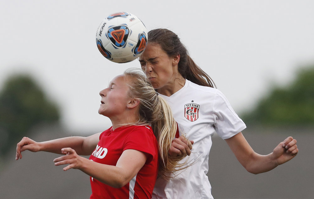 Troy Triad's Kalie Gibbs and Glenwood's Carlie Smith head the ball during the Class 2A Sectional final Friday, May 26, 2017. [Ted Schurter/The State Journal-Register]