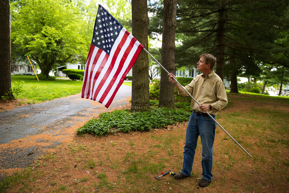 Neal Miller adjusts the height of a flag pole before installing it in a Springfield yard as part of the Rotary Flag Service Thursday, May 25, 2017. For a $50 annual fee, the Springfield Rotary Foundation will place a flag on your property shortly before Memorial Day, Flag Day, the Fourth of July and Labor Day and pick it up afterwards.. [Ted Schurter/The State Journal-Register]