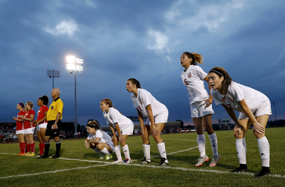 The Glenwood Titans watch as their bid to beat Troy Triad fails after two overtimes and a penalty kick shootout during the Class 2A Sectional final Friday, May 26, 2017. [Ted Schurter/The State Journal-Register]