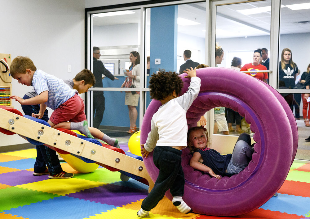 Sam Smith pushes a foam wheel to the delight of Roslyn Patterson in the play room of the new Noll Cafe on Ginger Creek Drive Tuesday, May 23, 2017 after the new facility officially opened. The cafe has a mission of inclusion for children with disabilities, while it also serves as a place of employment for students in Hope Institute's Vocational Program. [Rich Saal/The State Journal-Register]