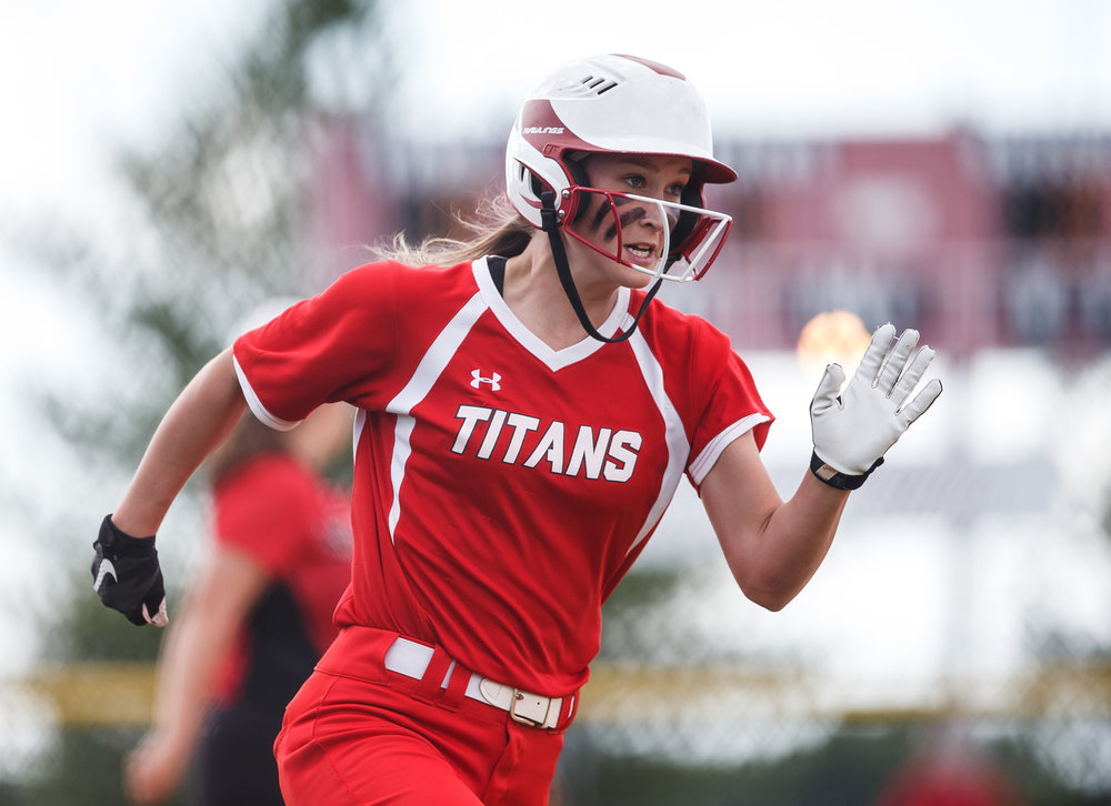Glenwood's Olivia McClintock (11) heads to home plate to score a run to get the Titans on the board behind 2-1 against Mt. Zion in the first inning during the Class 3A Glenwood Sectional semifinals at Glenwood High School, Tuesday, May 30, 2017, in Chatham, Ill. [Justin L. Fowler/The State Journal-Register]