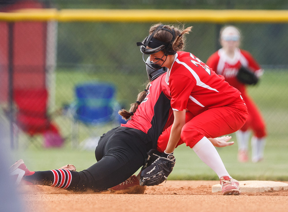 Glenwood's Maddie Wichmann (25) finishes a double play by tagging out Mt. Zion's Dayna Kennedy (22) as the two collide at second base in the first inning during the Class 3A Glenwood Sectional semifinals at Glenwood High School, Tuesday, May 30, 2017, in Chatham, Ill. [Justin L. Fowler/The State Journal-Register]