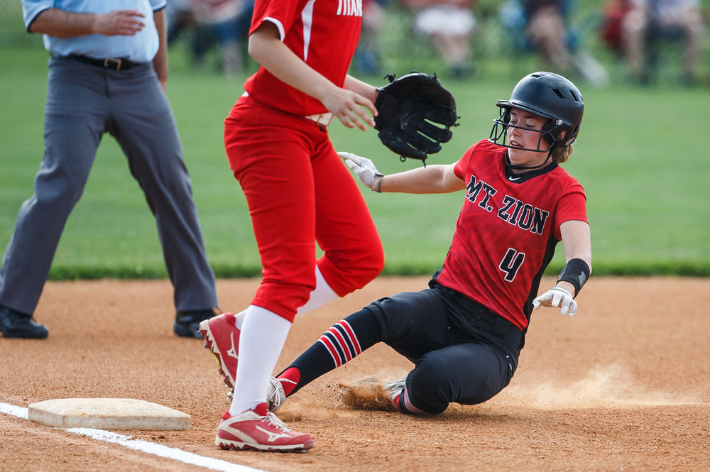 Mt. Zion's Alli Davis (4) steals third base in the first inning against Glenwood in the Class 3A Glenwood Sectional semifinals at Glenwood High School, Tuesday, May 30, 2017, in Chatham, Ill. [Justin L. Fowler/The State Journal-Register]