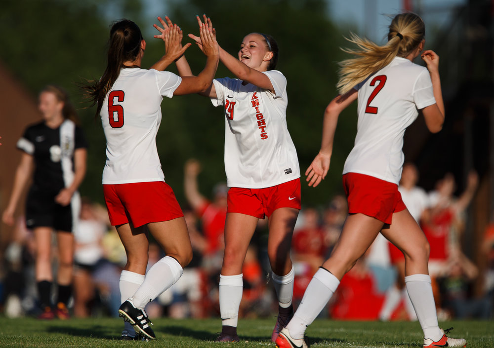 Troy Triad's Madeline Keller (6) gets a high five from Troy Triad's Sydney Beach (19) after scoring a goal against Sacred Heart-Griffin to make it 1-0 in the second half during the Class 2A Rochester Supersectional at Rochester Elementary School, Tuesday, May 30, 2017, in Rochester, Ill. [Justin L. Fowler/The State Journal-Register]