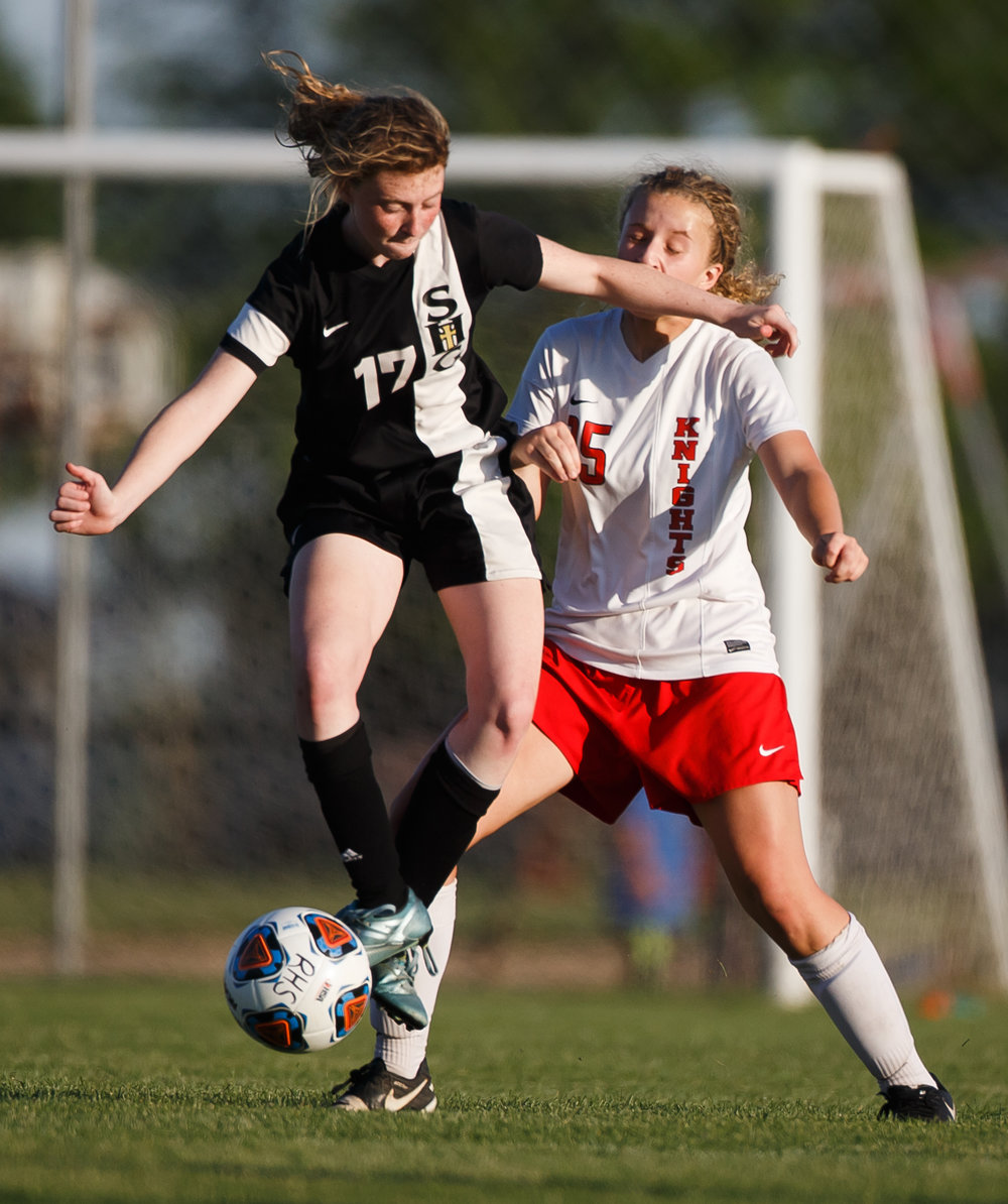Troy Triad's Eryn Fanning (15) takes an elbow to the face as Sacred Heart-Griffin's Grace Kuchar (17) inadvertently makes contact going for a ball out of the air in the second half during the Class 2A Rochester Supersectional at Rochester Elementary School, Tuesday, May 30, 2017, in Rochester, Ill. [Justin L. Fowler/The State Journal-Register]
