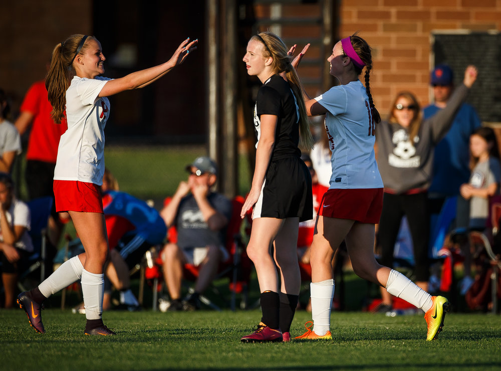 Sacred Heart-Griffin's Macy Vorreyer (8) reacts as Troy Triad celebrates their 1-0 victory over SHG in the Class 2A Rochester Supersectional at Rochester Elementary School, Tuesday, May 30, 2017, in Rochester, Ill. [Justin L. Fowler/The State Journal-Register]