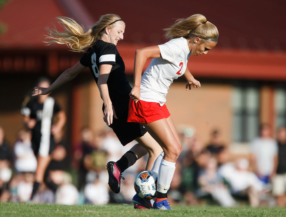 Troy Triad's Sierra Schlemmer (23) steals the ball away from Sacred Heart-Griffin's Macy Vorreyer (8) in the first half during the Class 2A Rochester Supersectional at Rochester Elementary School, Tuesday, May 30, 2017, in Rochester, Ill. [Justin L. Fowler/The State Journal-Register]