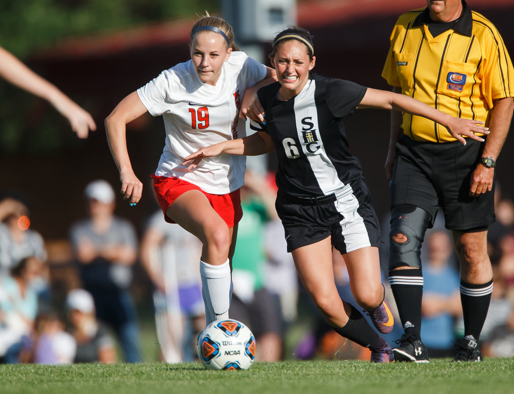 Sacred Heart-Griffin's Karmen Vicari-Endres (6) and Troy Triad's Sydney Beach (19) jockey for position to gain possession of the ball in the first half during the Class 2A Rochester Supersectional at Rochester Elementary School, Tuesday, May 30, 2017, in Rochester, Ill. [Justin L. Fowler/The State Journal-Register]