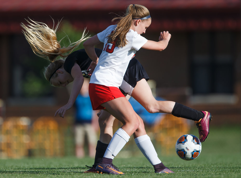 Sacred Heart-Griffin's Macy Vorreyer (8) gets upended by Troy Triad's Sydney Beach (19) as they tangle for possession of the ball in the first half during the Class 2A Rochester Supersectional at Rochester Elementary School, Tuesday, May 30, 2017, in Rochester, Ill. [Justin L. Fowler/The State Journal-Register]
