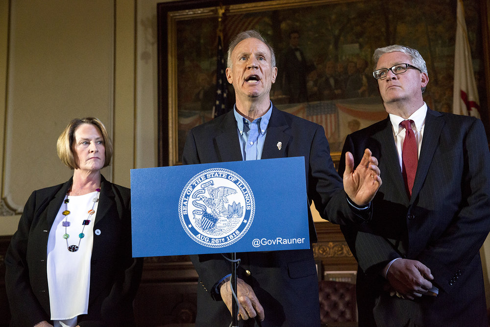 """Gov. Bruce Rauner, who was accompanied by Senate Minority Leader Christine Radogno and House Republican Leader Jim Durkin at a press conference in his office at the Capitol, accused Democrats in the General Assembly of """"dereliction of duty"""" for not having a balanced budget to vote on Wednesday, May 31, 2017 in Springfield, Ill. House Speaker Michael Madigan said earlier that there would be no budget vote in the House.[Rich Saal/The State Journal-Register]"""