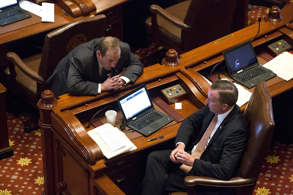 Sen. Andy Manar, D-Bunker Hill, right, talks with Toby Trimmer, a Senate Democratic staff member, on the floor of the Senate Wednesday, May 31, 2017 at the Capitol in Springfield, Ill. [Rich Saal/The State Journal-Register]