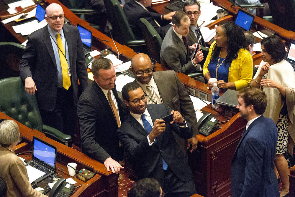 Rep. Christian Mitchell, D-Chicago, snaps a selfie with Sen. Andy Manar, D-Bunker Hill, left, and Rep. William Davis, D-Homewood after their school funding overhaul bill passed in the the House Wednesday, May 31, 2017 at the Capitol. [Rich Saal/The State Journal-Register]