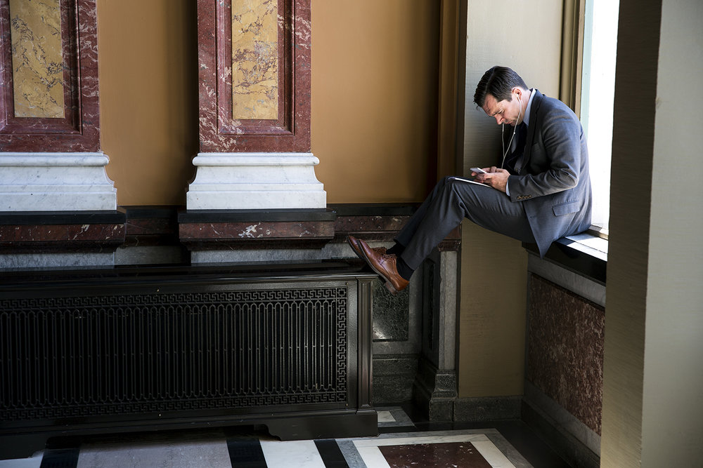 A man finds a spot at the south end of the Hall of Governors to get some work done at the Capitol Wednesday, May 31, 2017. [Rich Saal/The State Journal-Register]