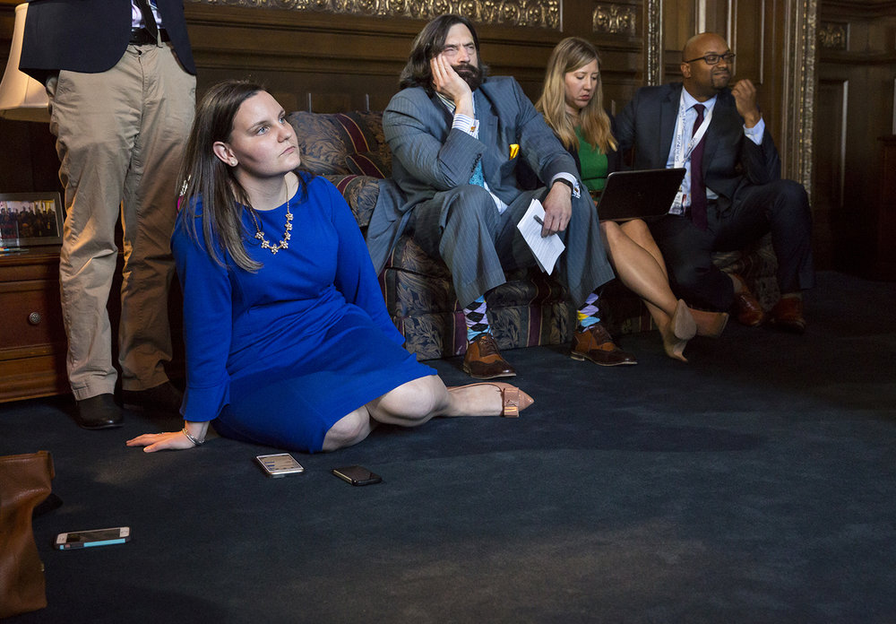 Gov. Rauner's spokeswoman, Catherine Kelly, listens to the governor's remarks during a press conference in his office at the Capitol Wednesday, May 31, 2017. [Rich Saal/The State Journal-Register]
