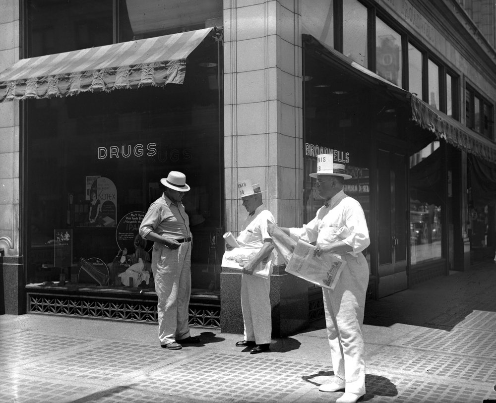 Kiwanis members selling War Cry, the Salvation Army newspaper, outside Broadwell Drugstore, northwest corner Fifth and Washington streets, June 1934. [File/The State Journal-Register]