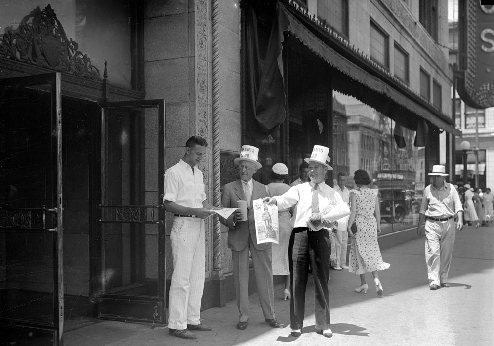 Kiwanis members selling War Cry, the Salvation Army newspaper, outside the Myers Brothers' building, June 1934. [File/The State Journal-Register]