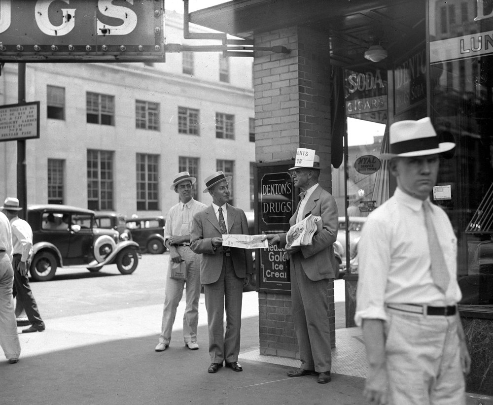 Kiwanis members selling War Cry, the Salvation Army newspaper, outside the Denton's Drug Store, southwest corner of Sixth and Monroe streets, June 1934. [File/The State Journal-Register]