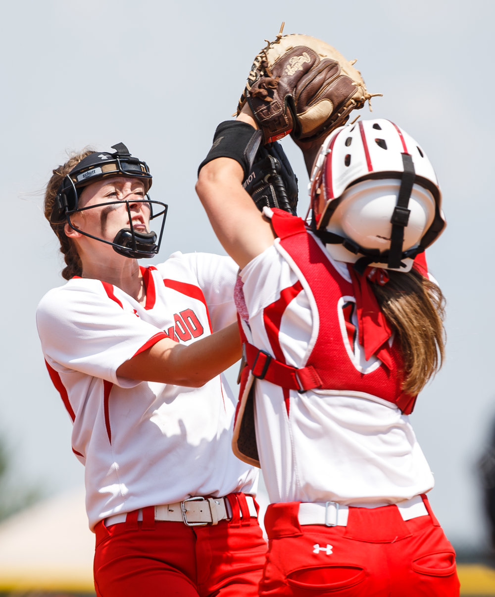 Glenwood's Sydney Paulauskis-Lauher (13) collides with Glenwood's Olivia McClintock (11) as they both go for a pop-up against Rochester in the third inning during the Class 3A Glenwood Sectional championship at Glenwood High School, Saturday, June 3, 2017, in Chatham, Ill. [Justin L. Fowler/The State Journal-Register]