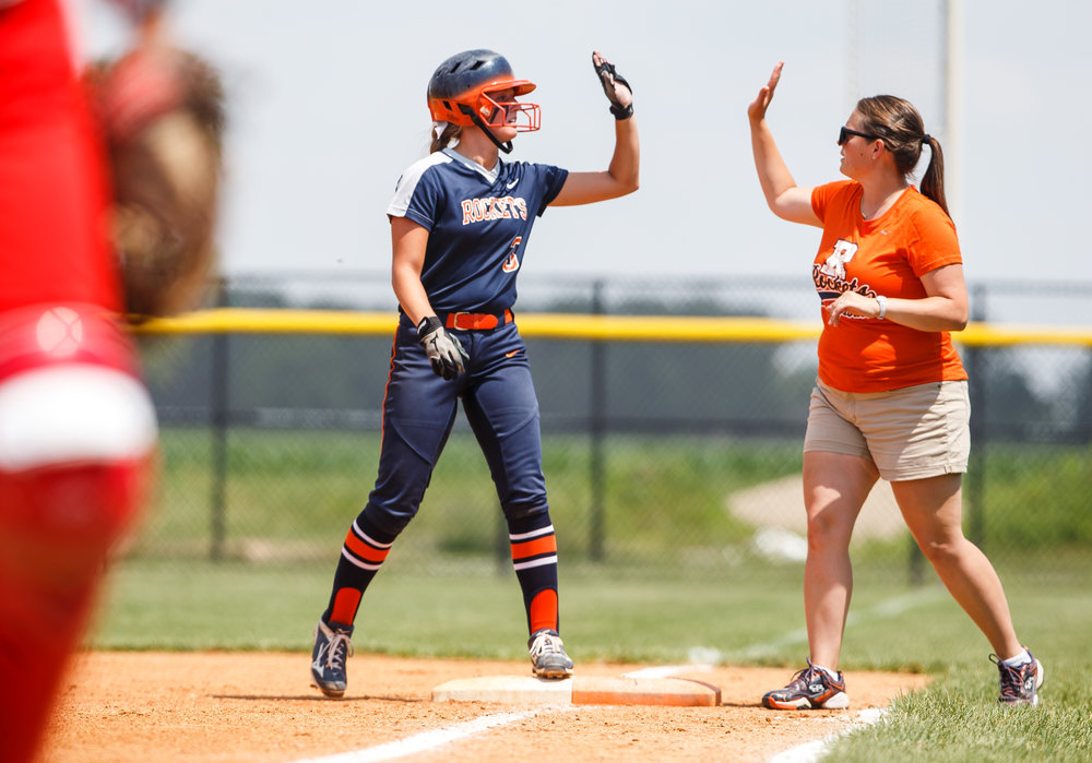 Rochester's Ali Bortmess (3) gets a high five at first base after a single in the third inning against Glenwood during the Class 3A Glenwood Sectional championship at Glenwood High School, Saturday, June 3, 2017, in Chatham, Ill. [Justin L. Fowler/The State Journal-Register]